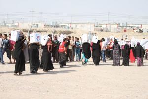 arabic.zakat.org - مؤسسة الزكاة الأميركية توزع الطرود الغذائية للنازحين العراقيين في ابريل